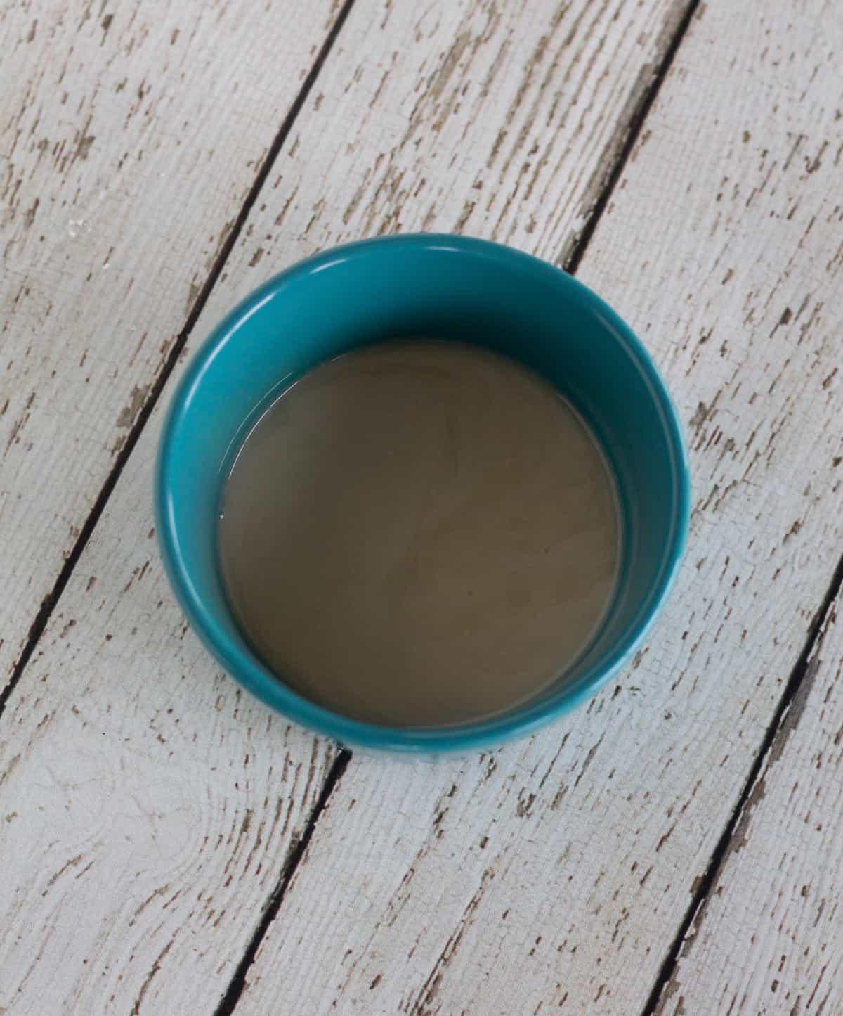 non-dairy milk and vinegar in small blue bowl