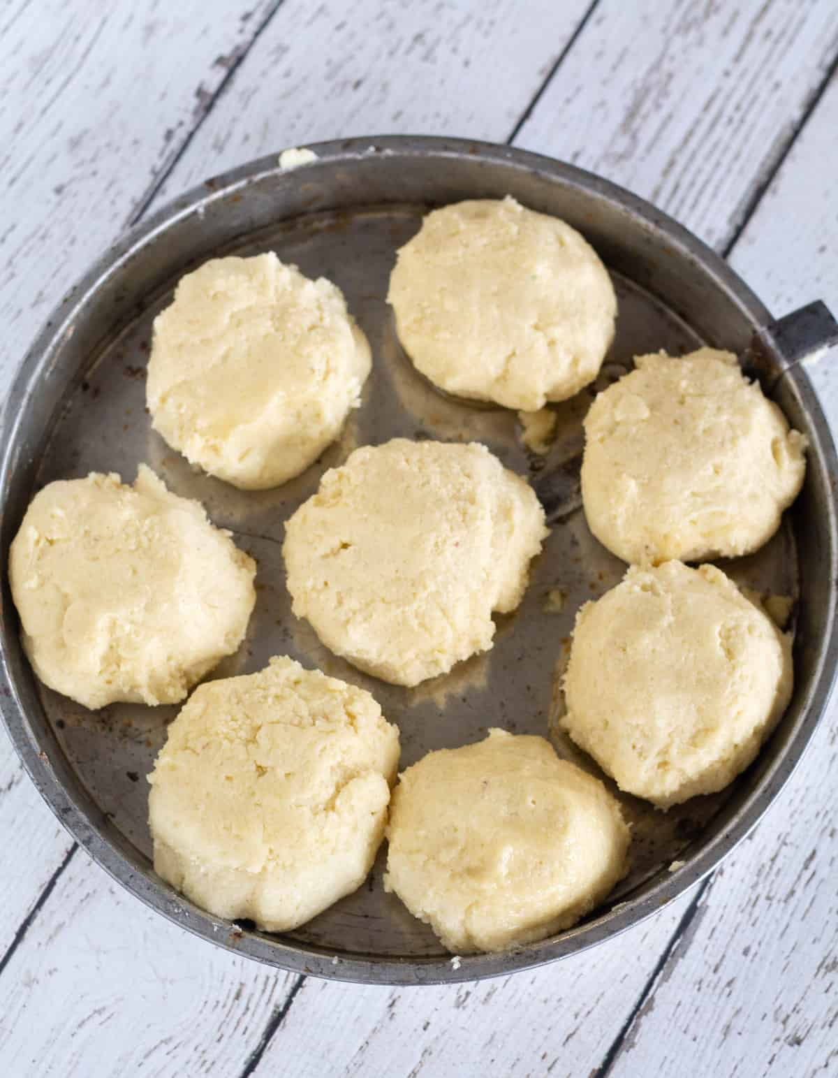 unbaked biscuits in pie dish