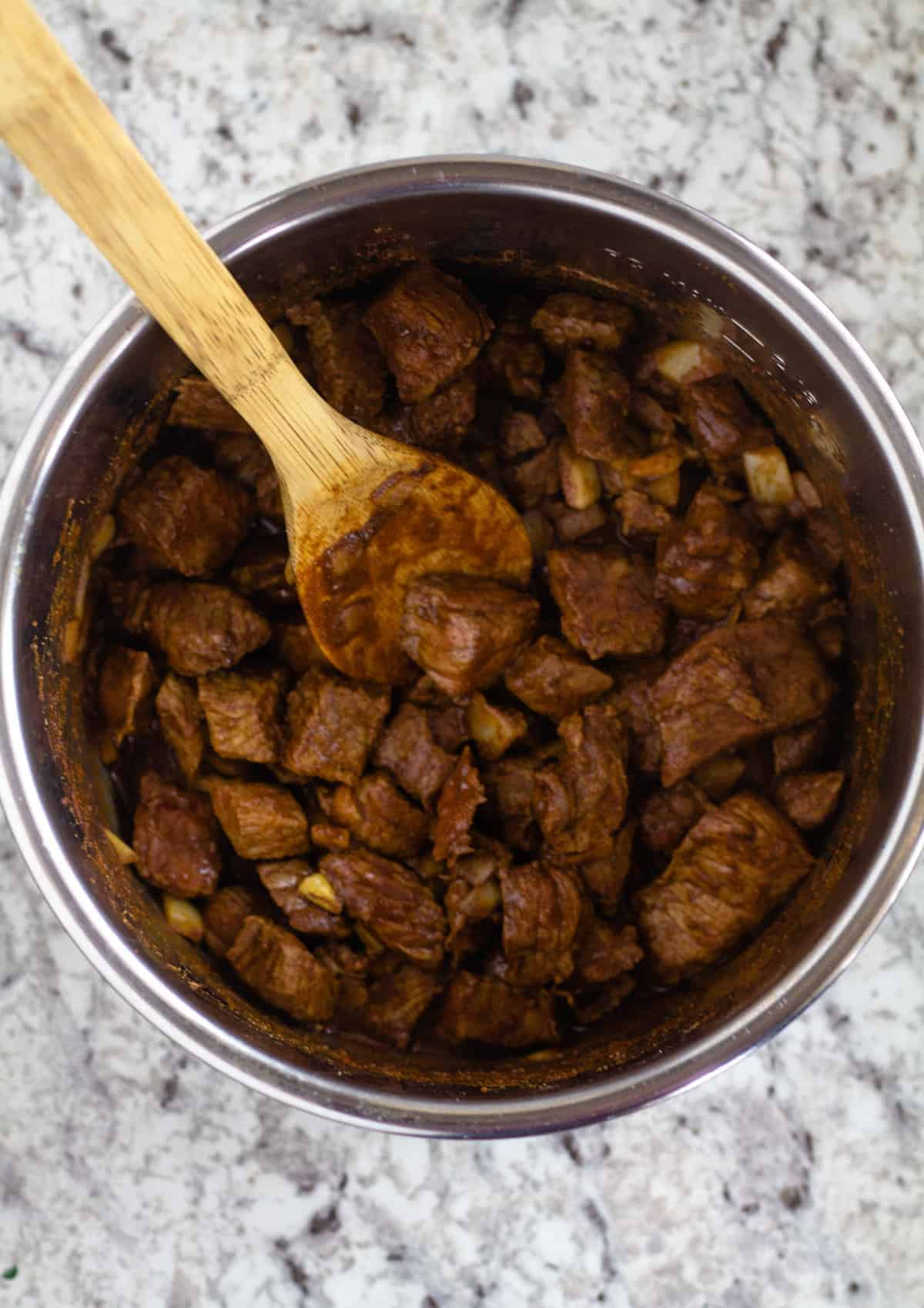 shredded beef in bowl on instant pot