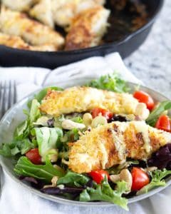 salad with coconut chicken on top with poppyseed dressing