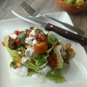 wedge taco salad on white plate