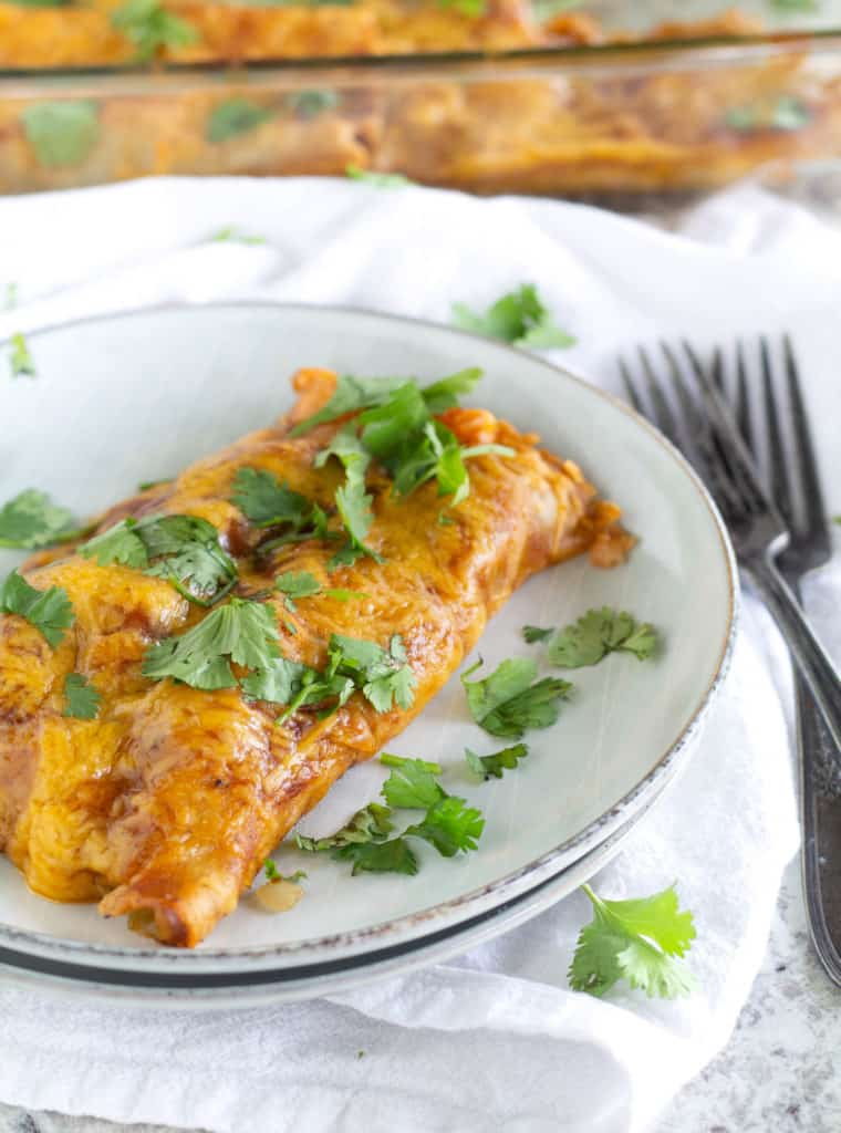 Two Paleo And Keto Beef Enchiladas on plate with cilantro sprinkled on top
