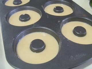 donut batter in donut tin