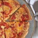 cutting a piece of keto flatbread pizza