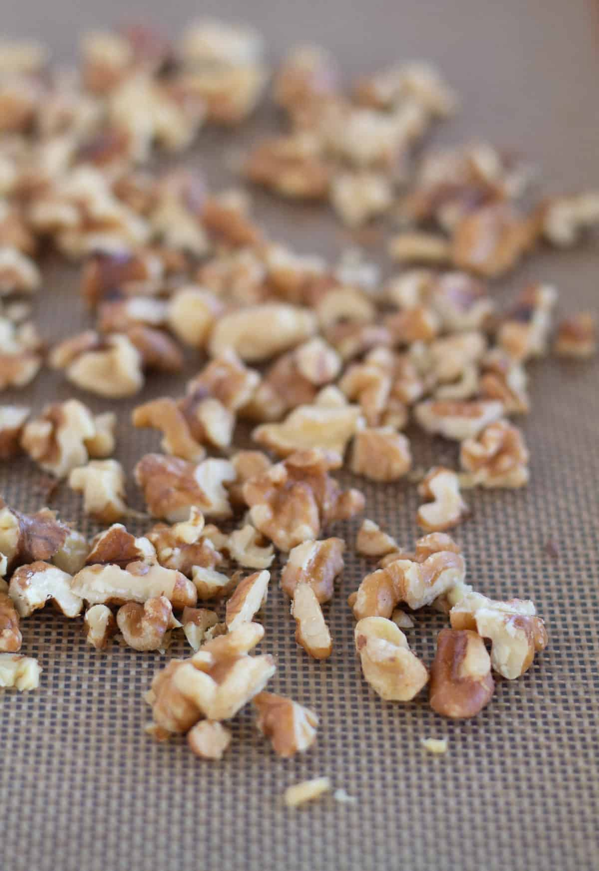 walnuts on a lined baking sheet