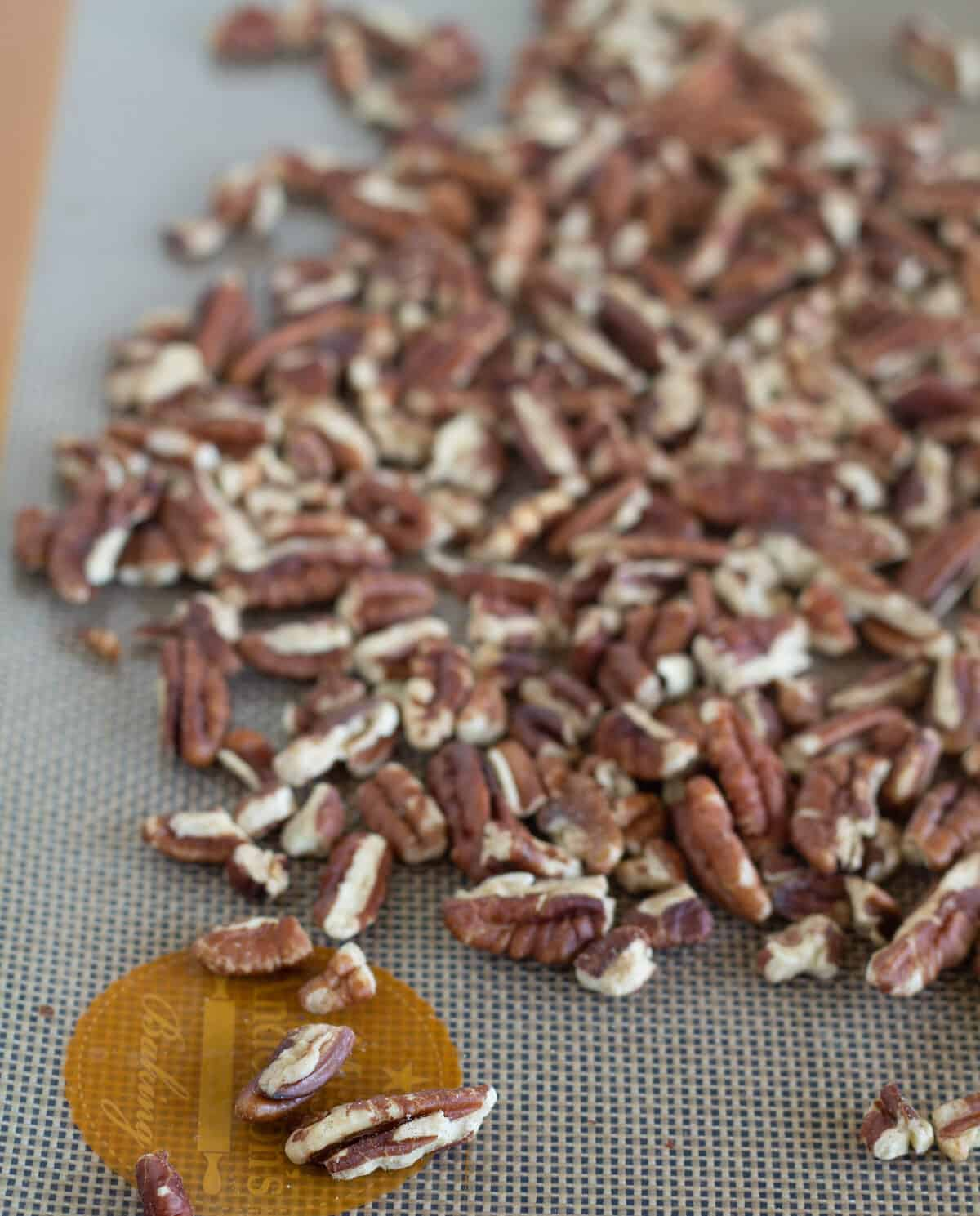 chopped pecans on silpat lined baking sheet