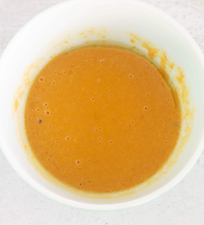 wet ingredients in white mixing bowl