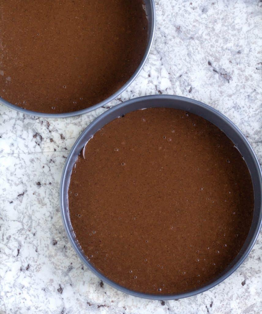 keto chocolate cake batter in cake pans