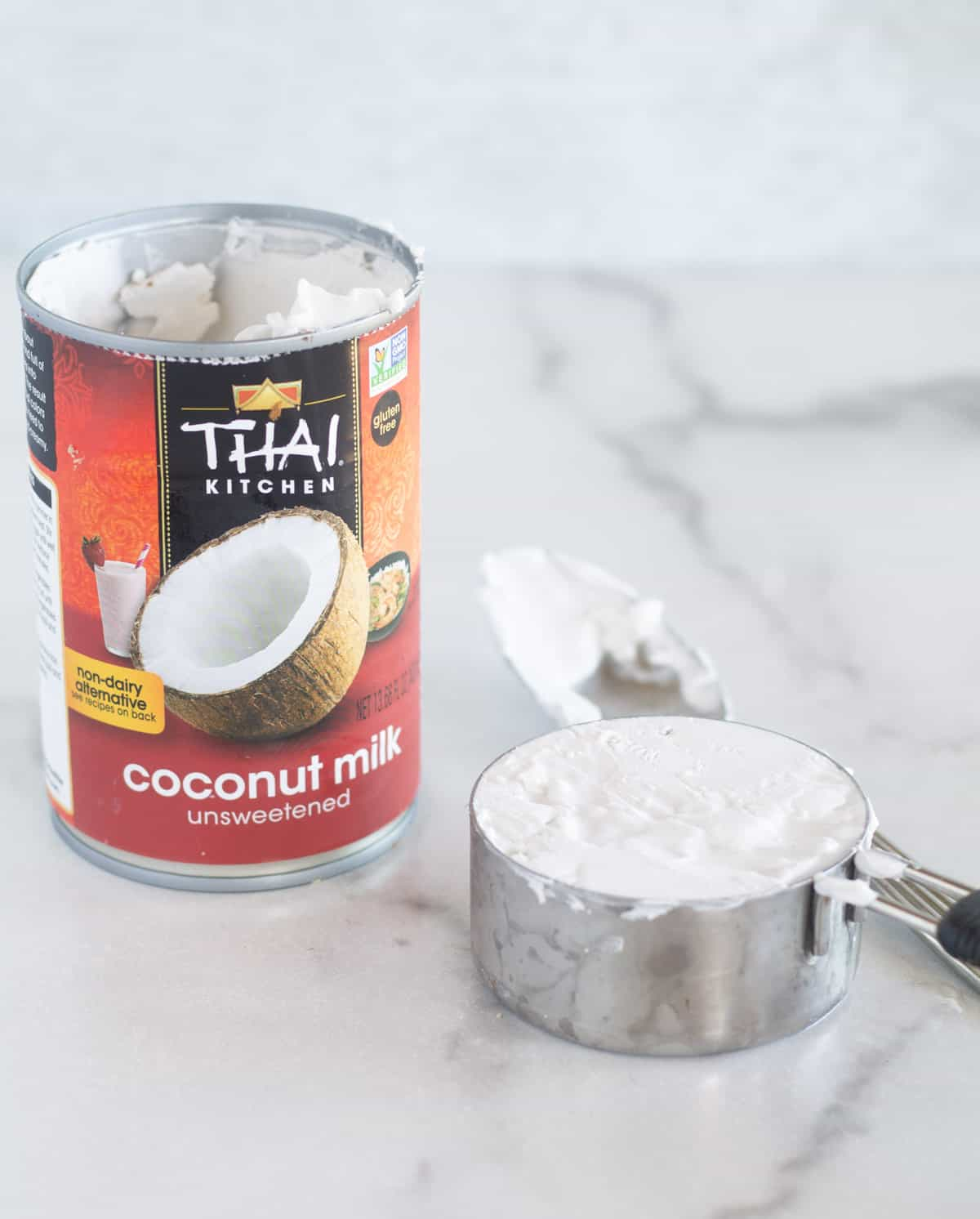 scooping out coconut cream from can
