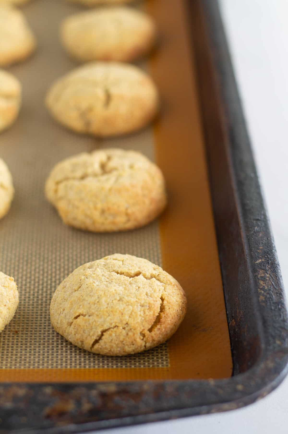 baked pumpkin cookie on silpat lined baking sheet