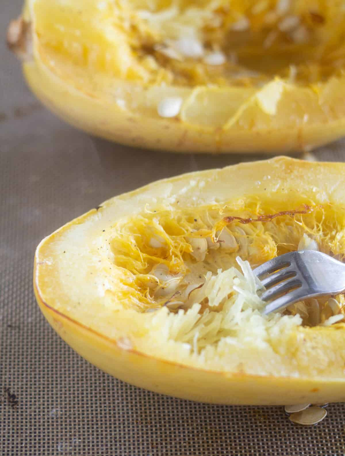 Scooping the flesh out of a spaghetti squash