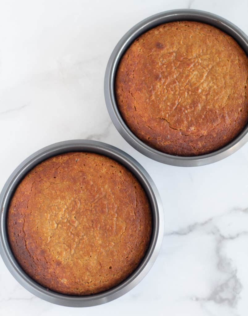 baked gingerbread cake in 2 round cake pans