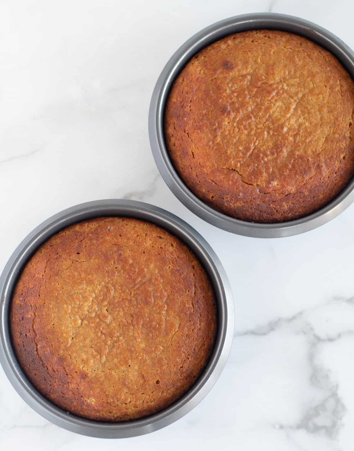 2 round baked cakes in pans