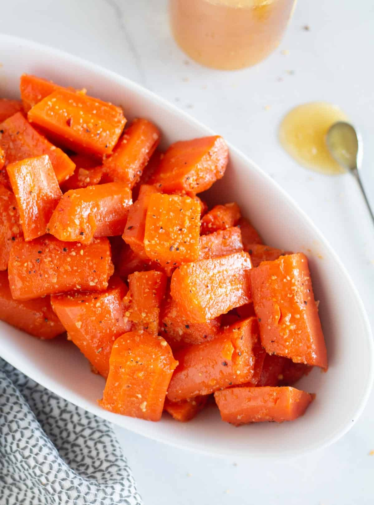 paleo honey glazed carrots in white bowl