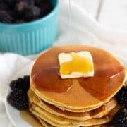 pancakes with butter, syrup, and blackberries