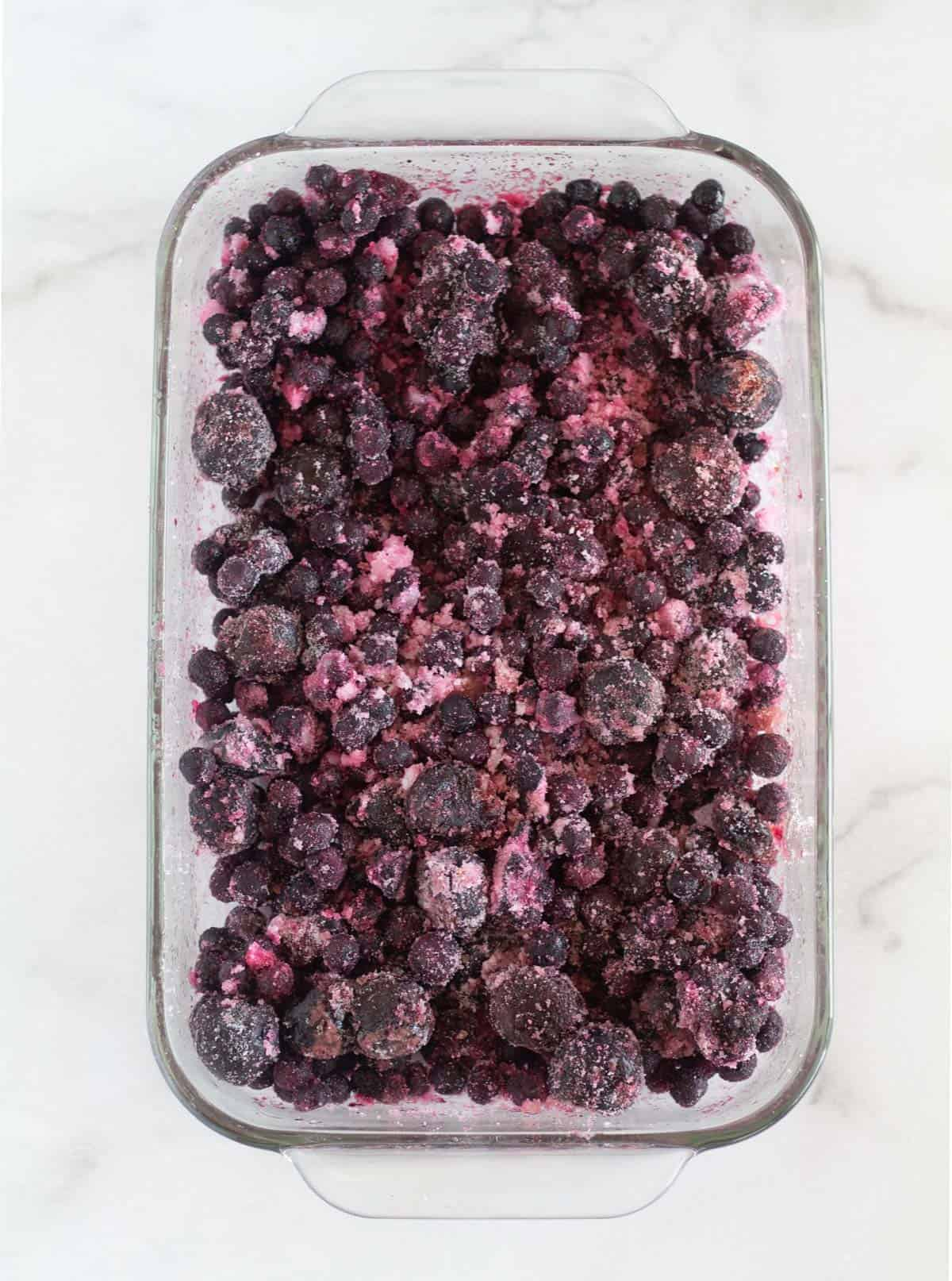 berries with sweetener and lemon juice in baking dish