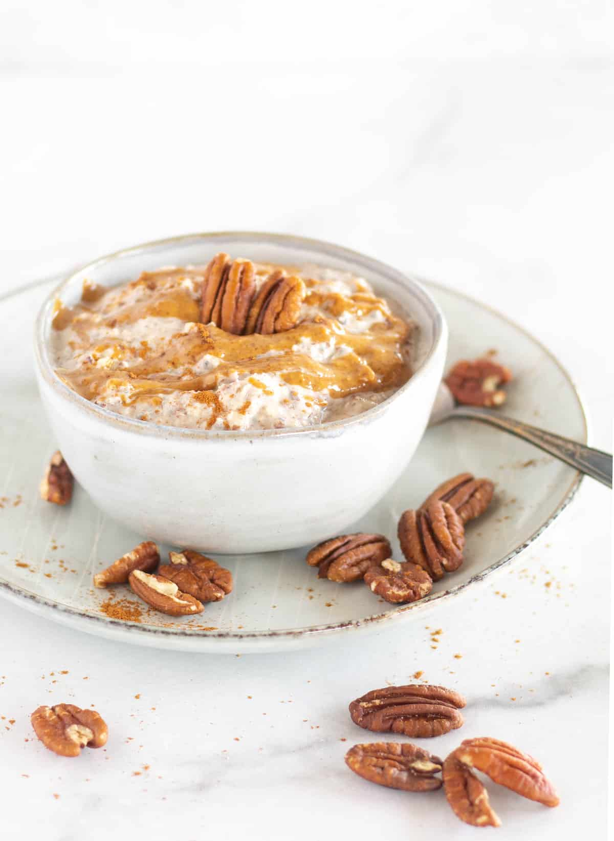 keto oatmeal in bowl with nut butter and pecans