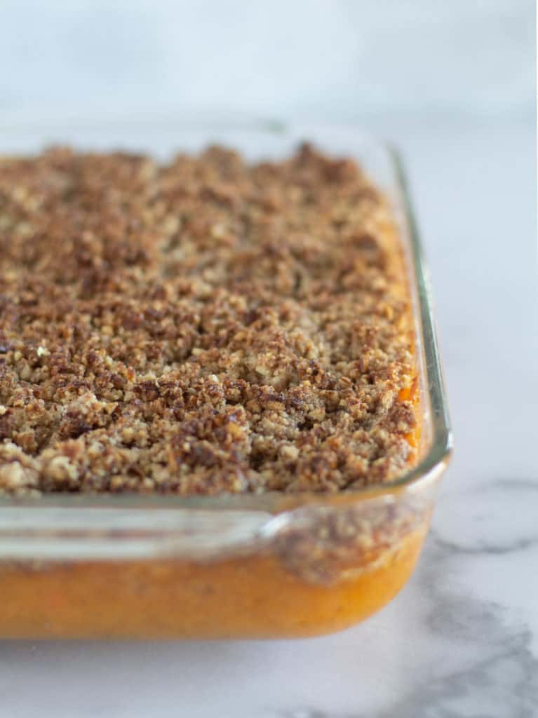 close up of Paleo, low-carb, and healthy sweet potato casserole in baking dish