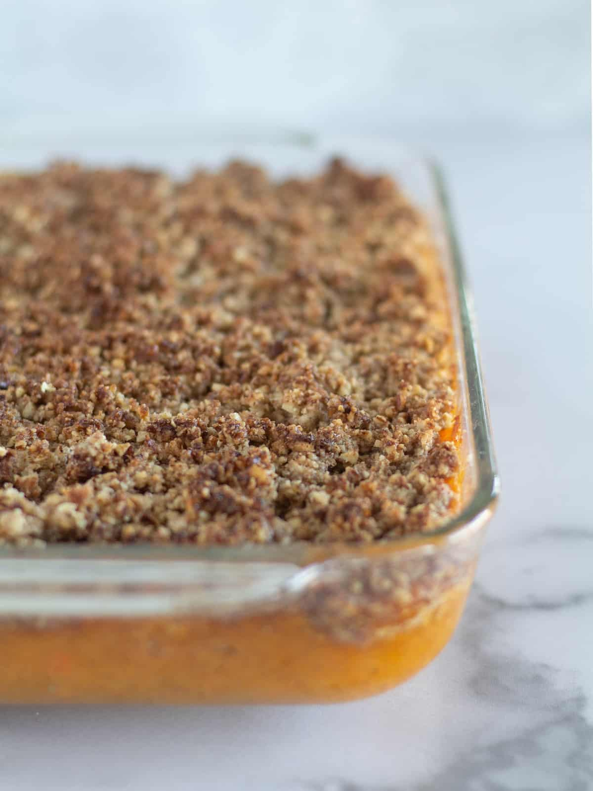 close up of sweet potato casserole in baking dish