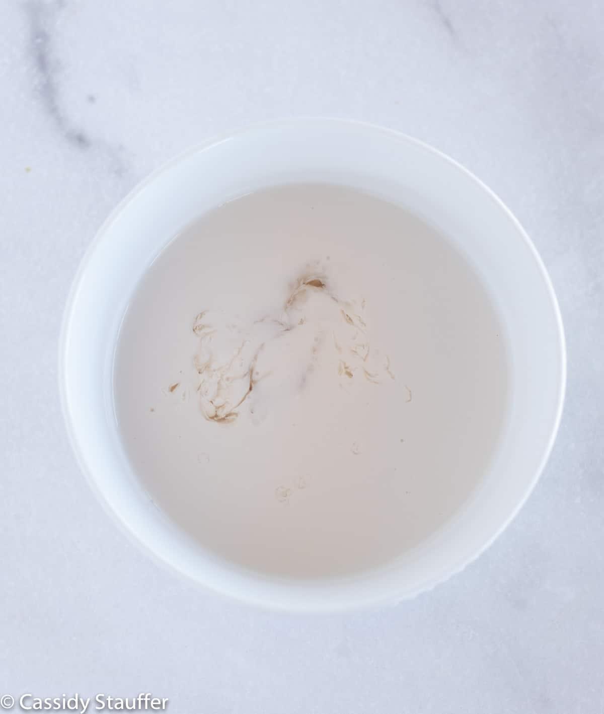 non dairy milk with vinegar in bowl