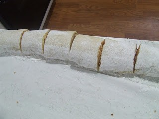 Rolled dough cut into rolls