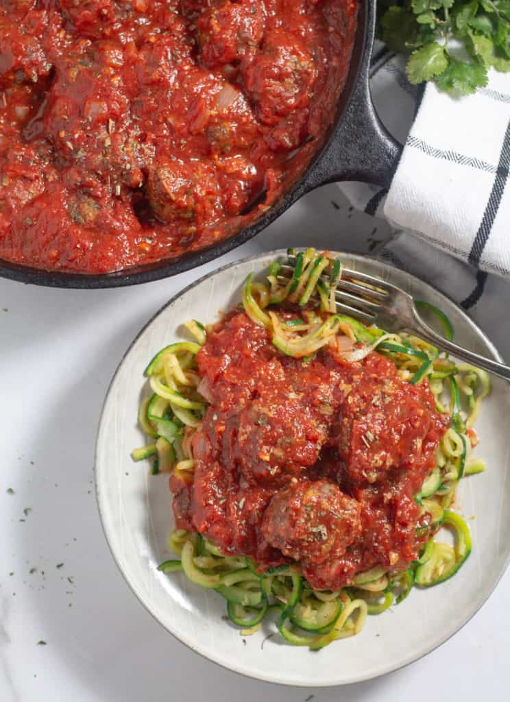 overhead shot of Italian keto meatballs over zucchini noodles