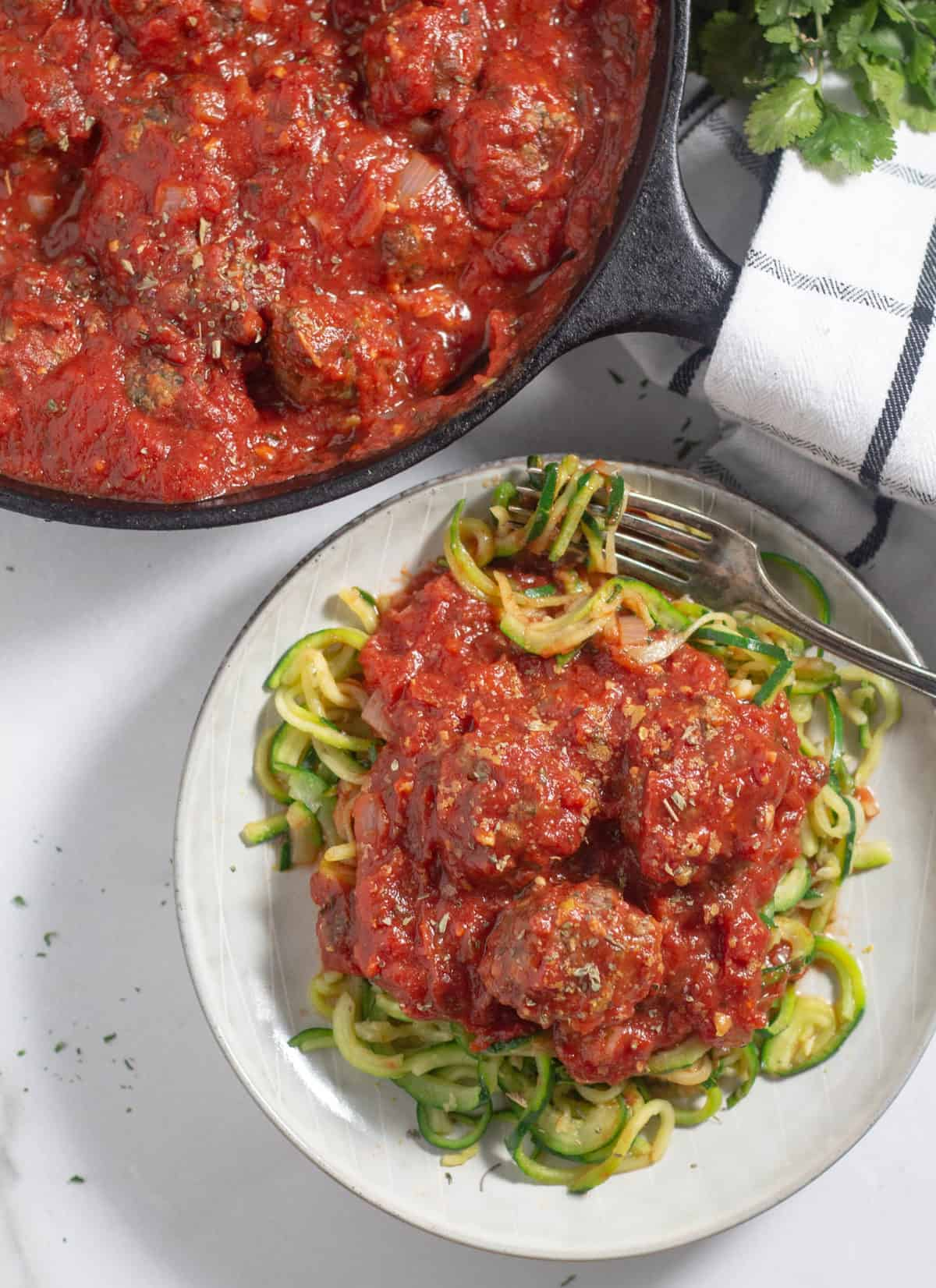 meatballs in marinara sauce over zucchini noodles