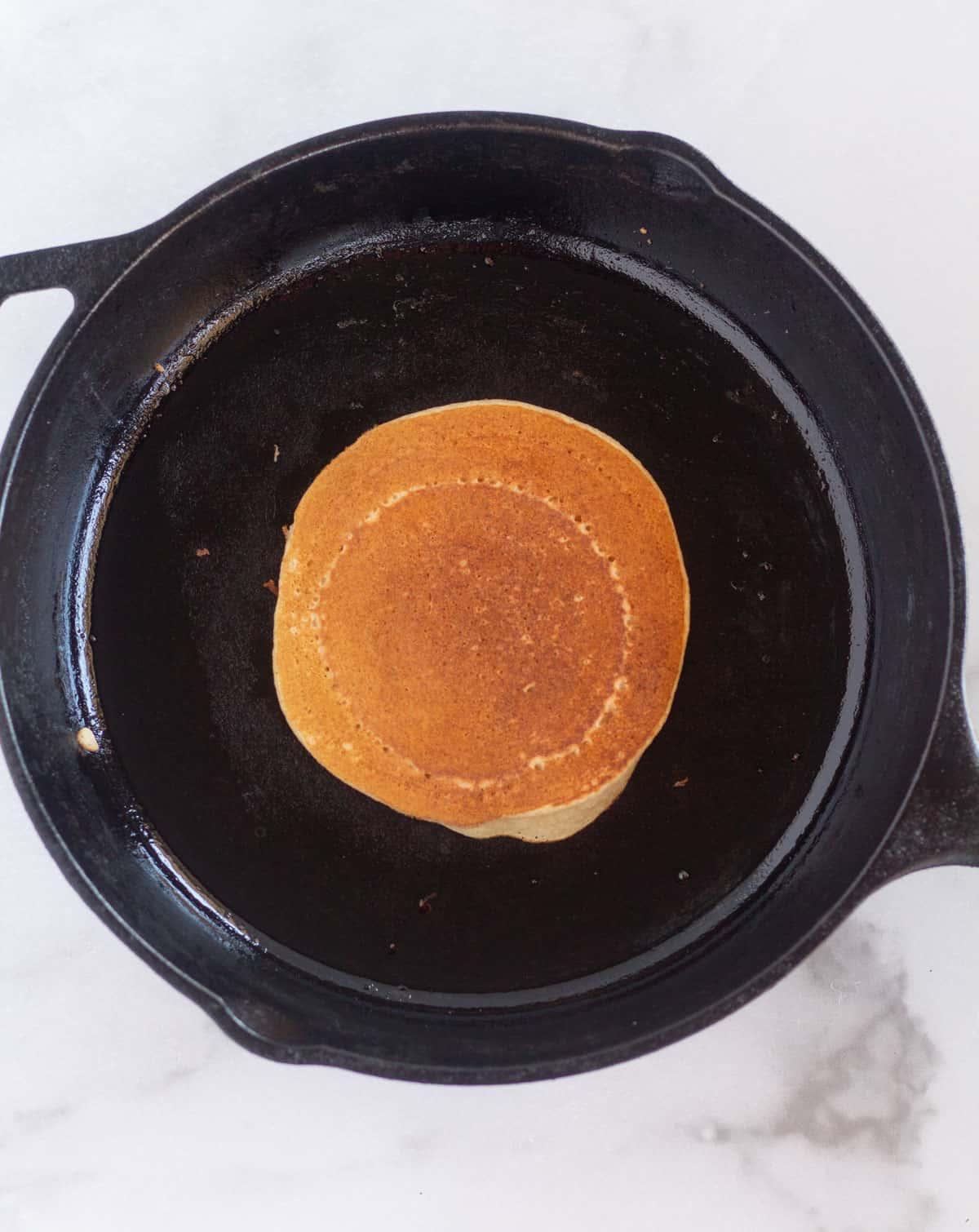flipped pancake in skillet