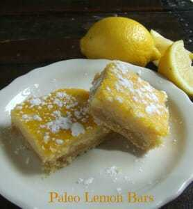 2 lemon bars on a white plate and dark background