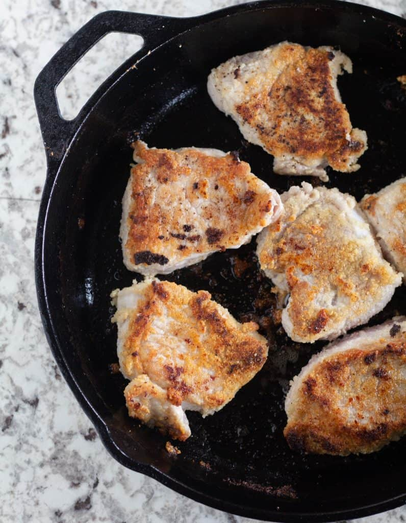 browned medallions in cast iron skillet