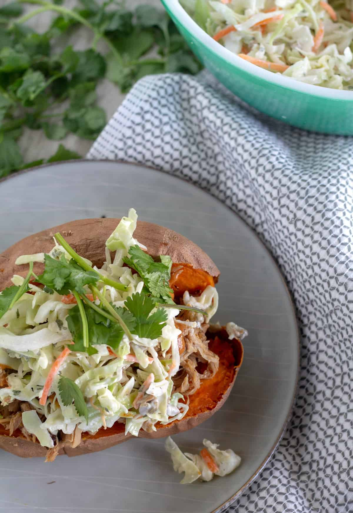 Overhead shot of sweet potato stuffed with pulled pork and slaw