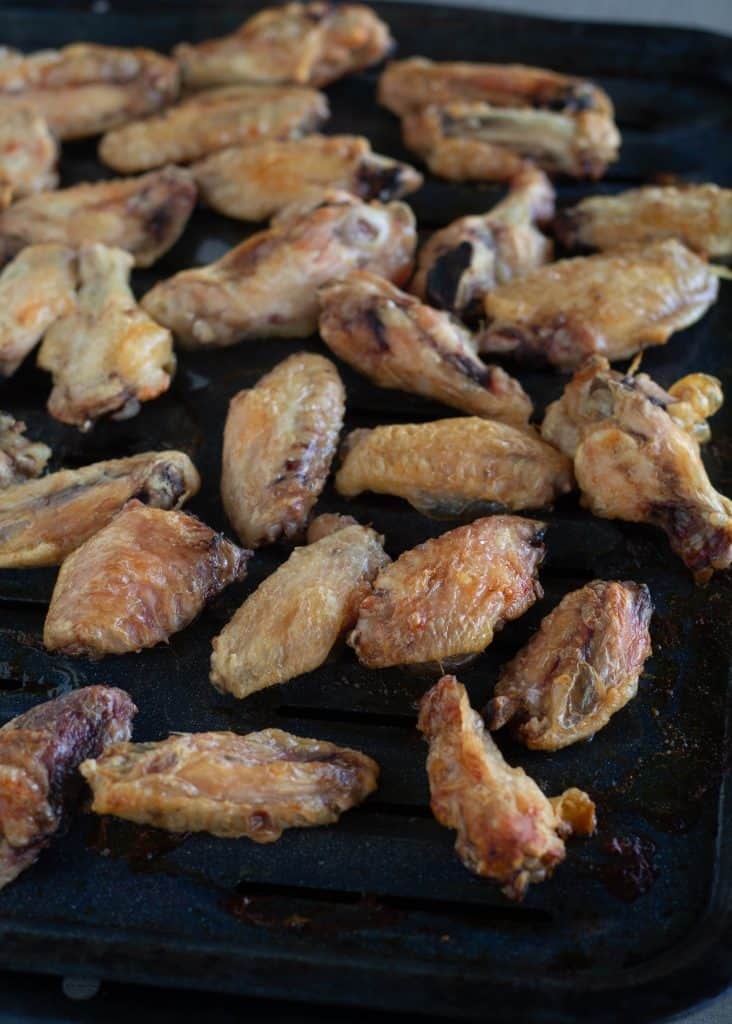crispy chicken wings on broiler pan