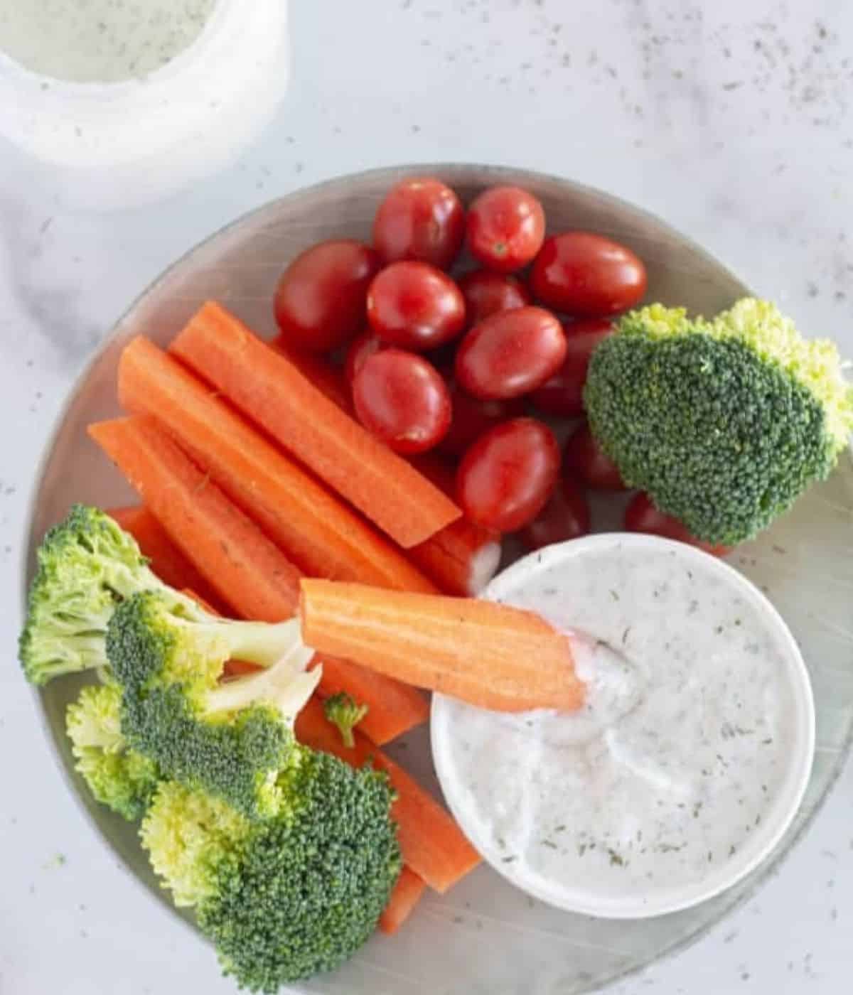 overhead shot of ranch dressing in bowl with veggies