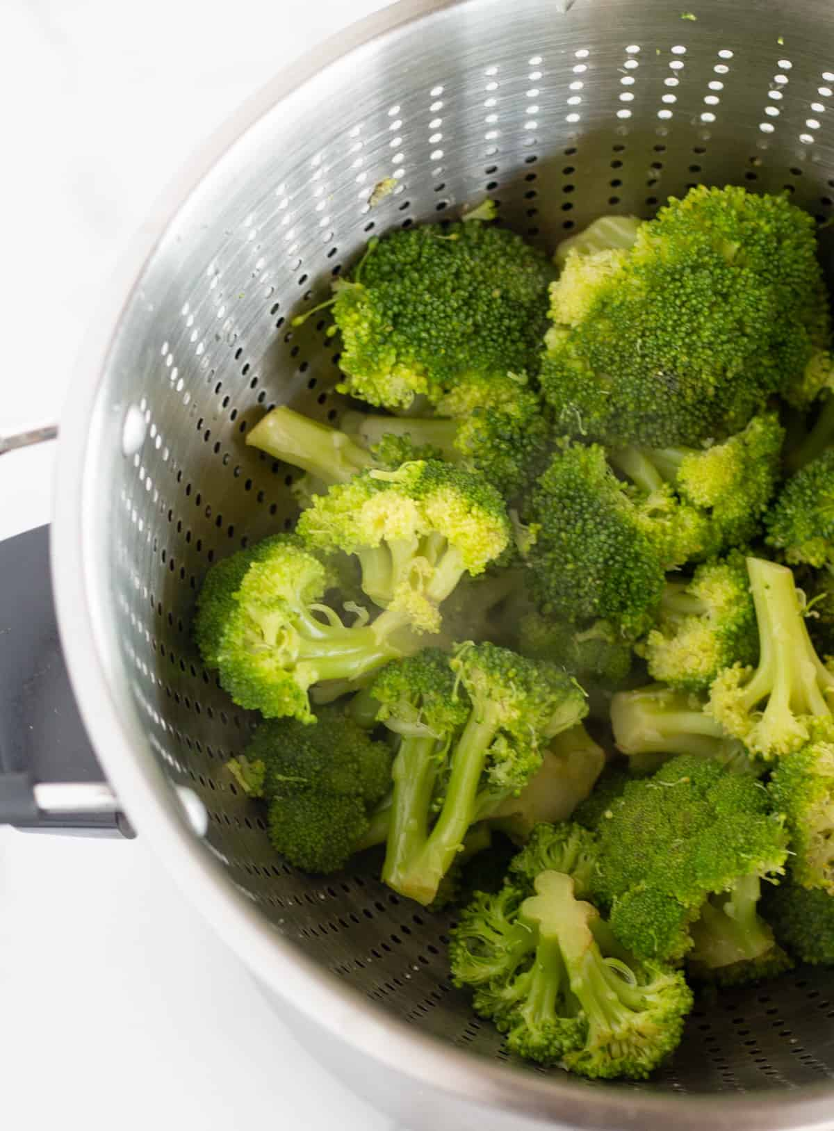 boiled broccoli in a collender