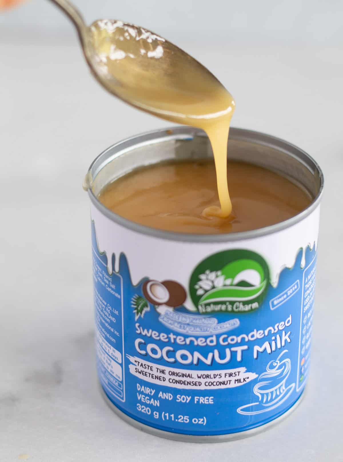 spooning dulce de leche out of the can