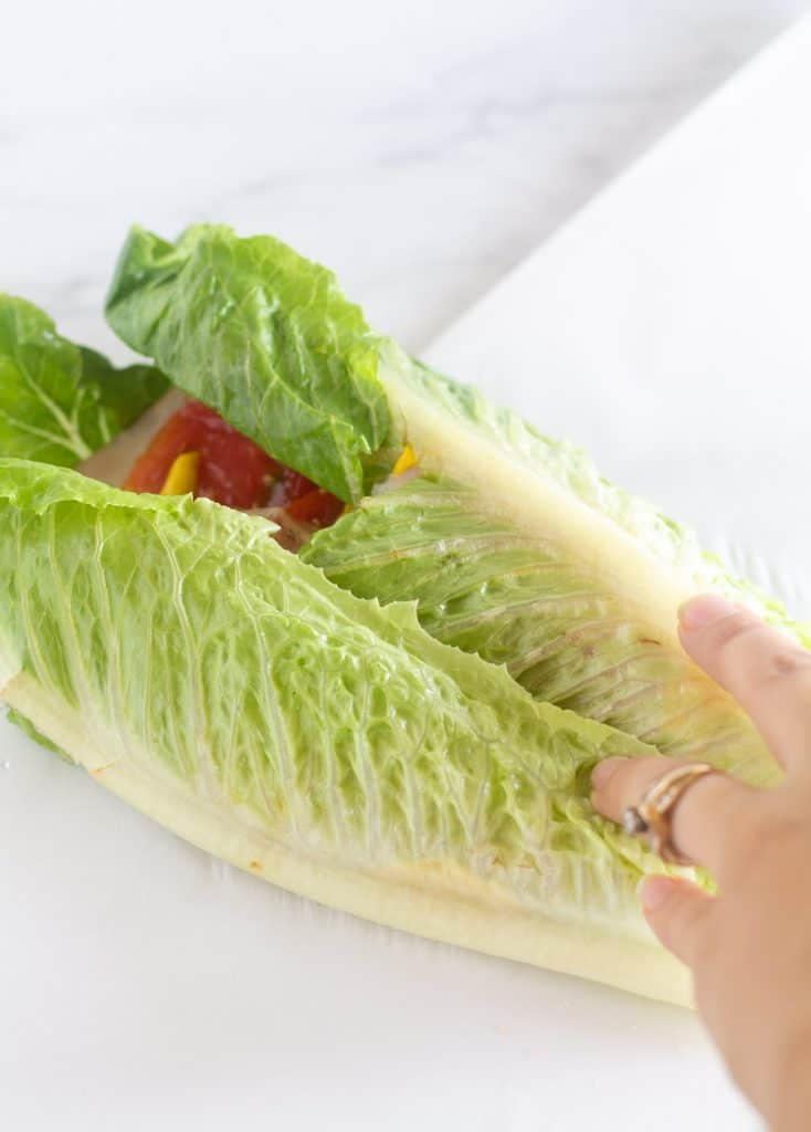 folding the lettuce over the toppings