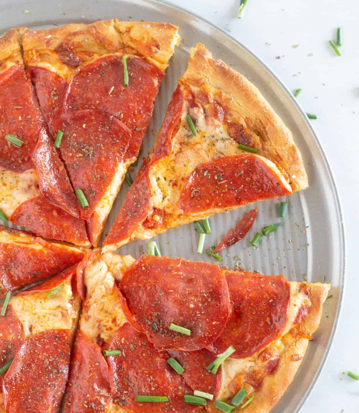 overhead shot of sliced pizza on pan