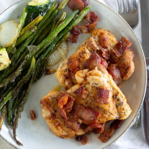 overhead shot of keto chicken and bacon with asparagus