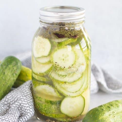 dill pickles in mason jar