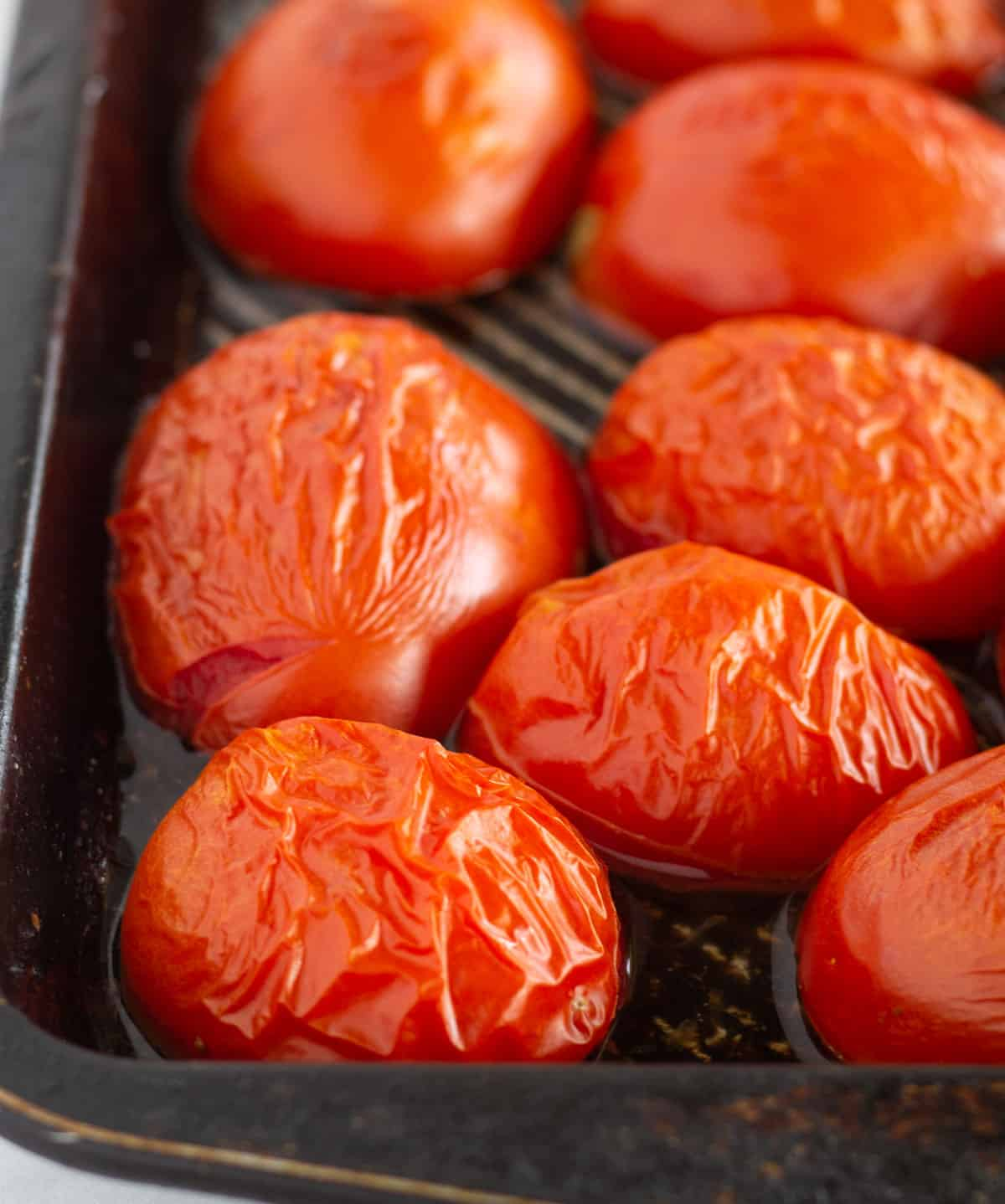 broiled tomatoes on baking sheet