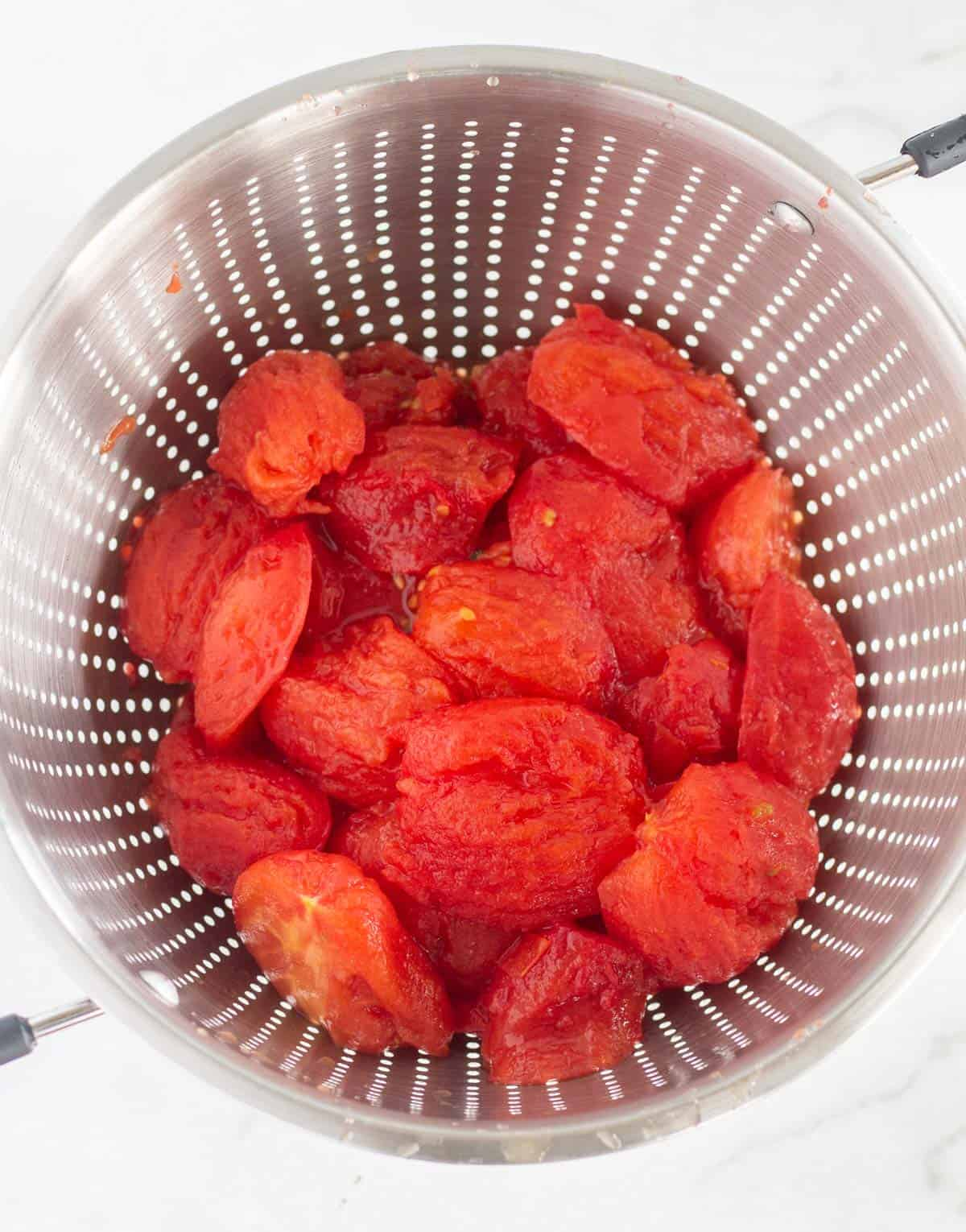 peeled tomatoes in collander