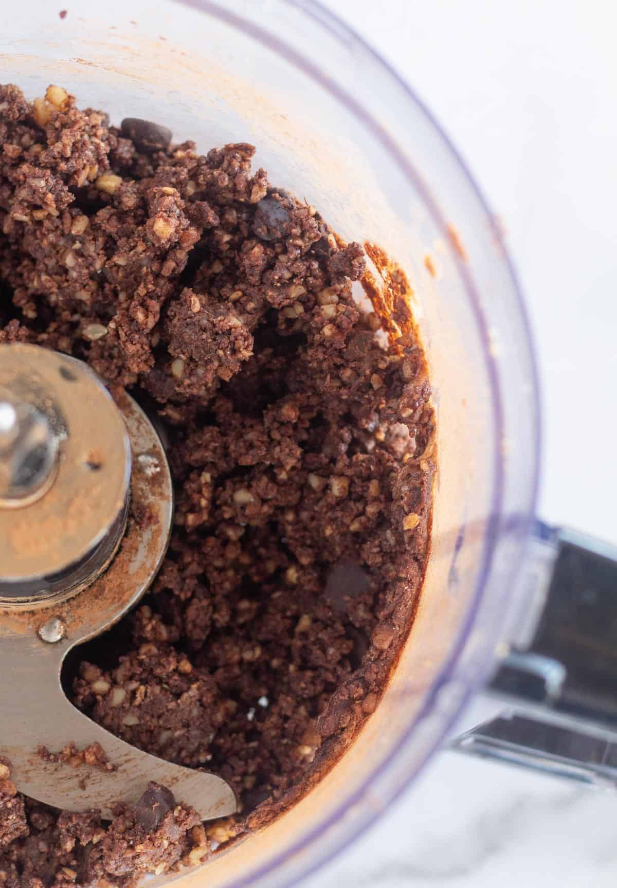 brownie bites batter in bowl of food processor