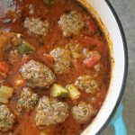 Overhead shot of meatball soup in a pot