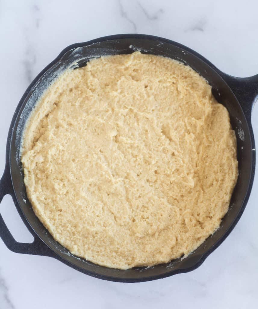 cornbread batter in cast iron skillet