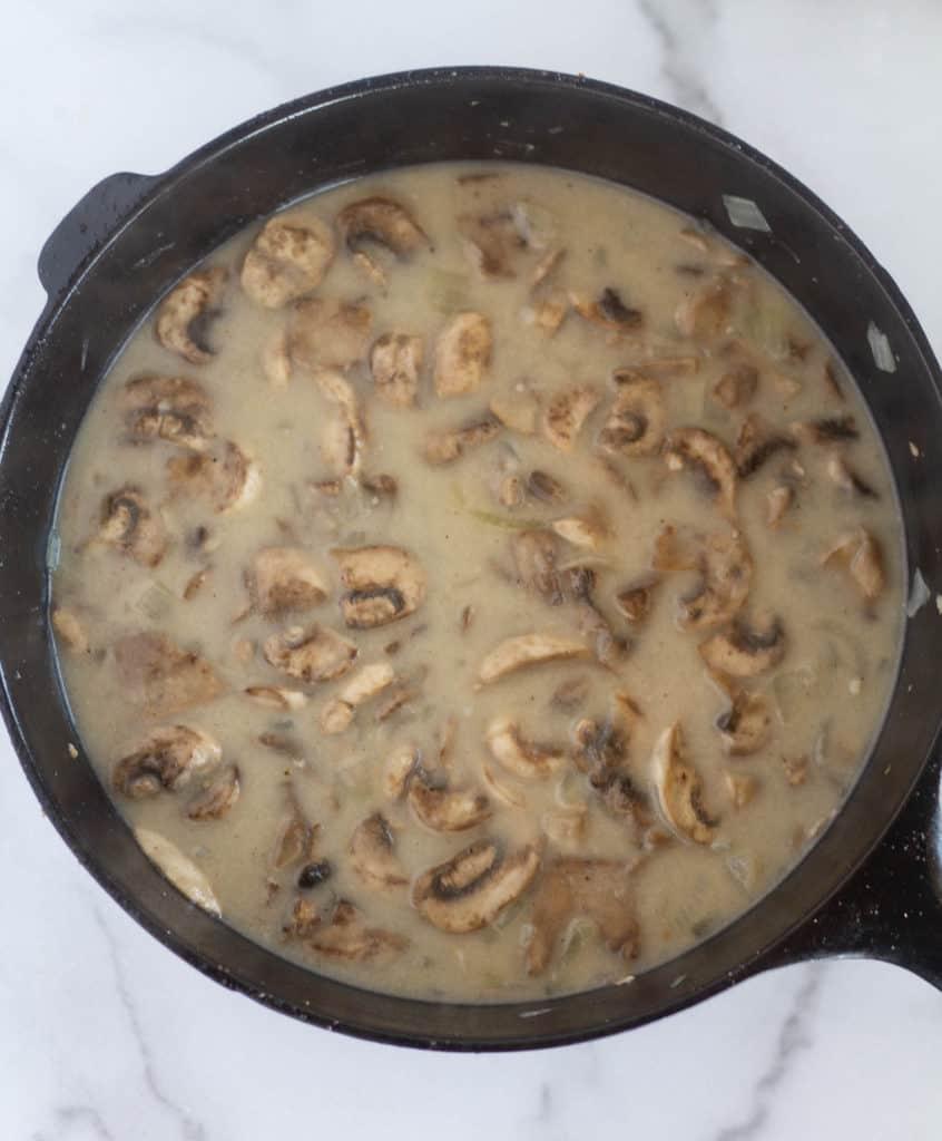 cream of mushroom soup in cast iron skillet before blending