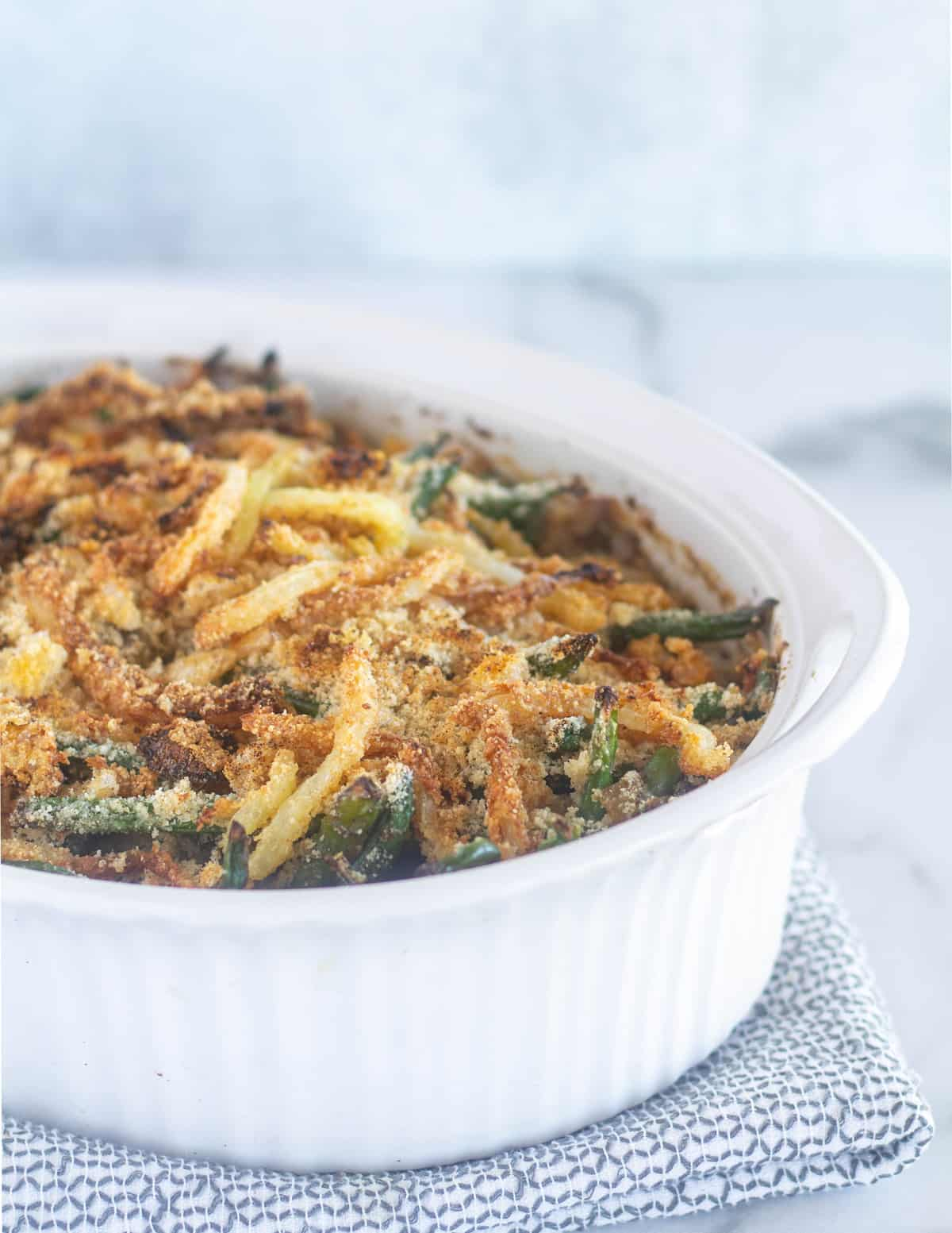 green bean casserole in white dish