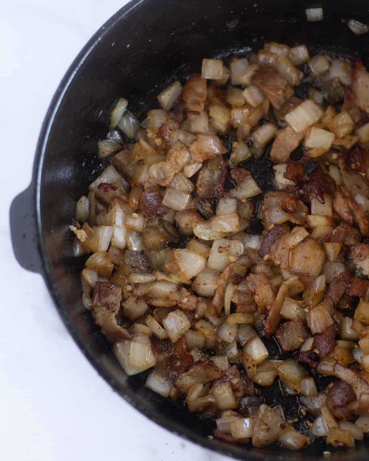 chopped bacon and onion in cast iron skillet