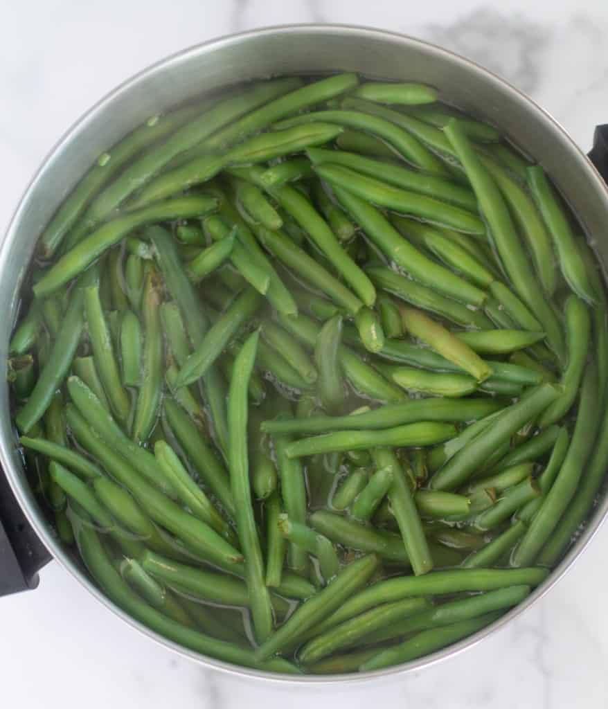 green beans boiling in large pot