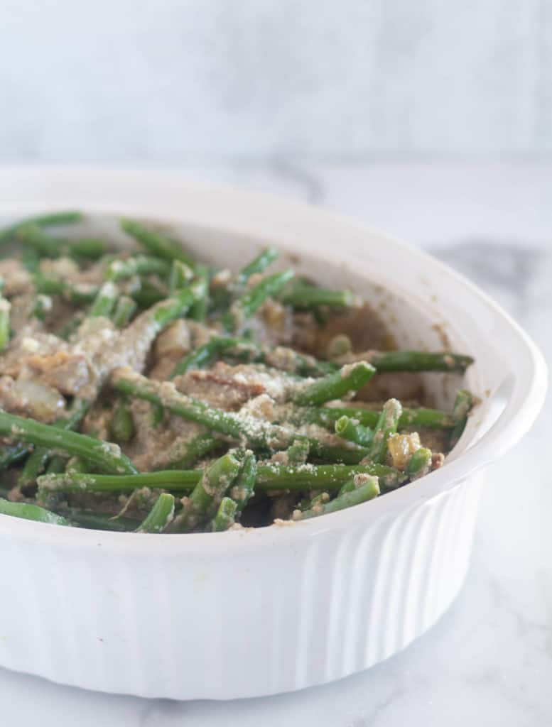 unbaked green bean casserole in white baking dish