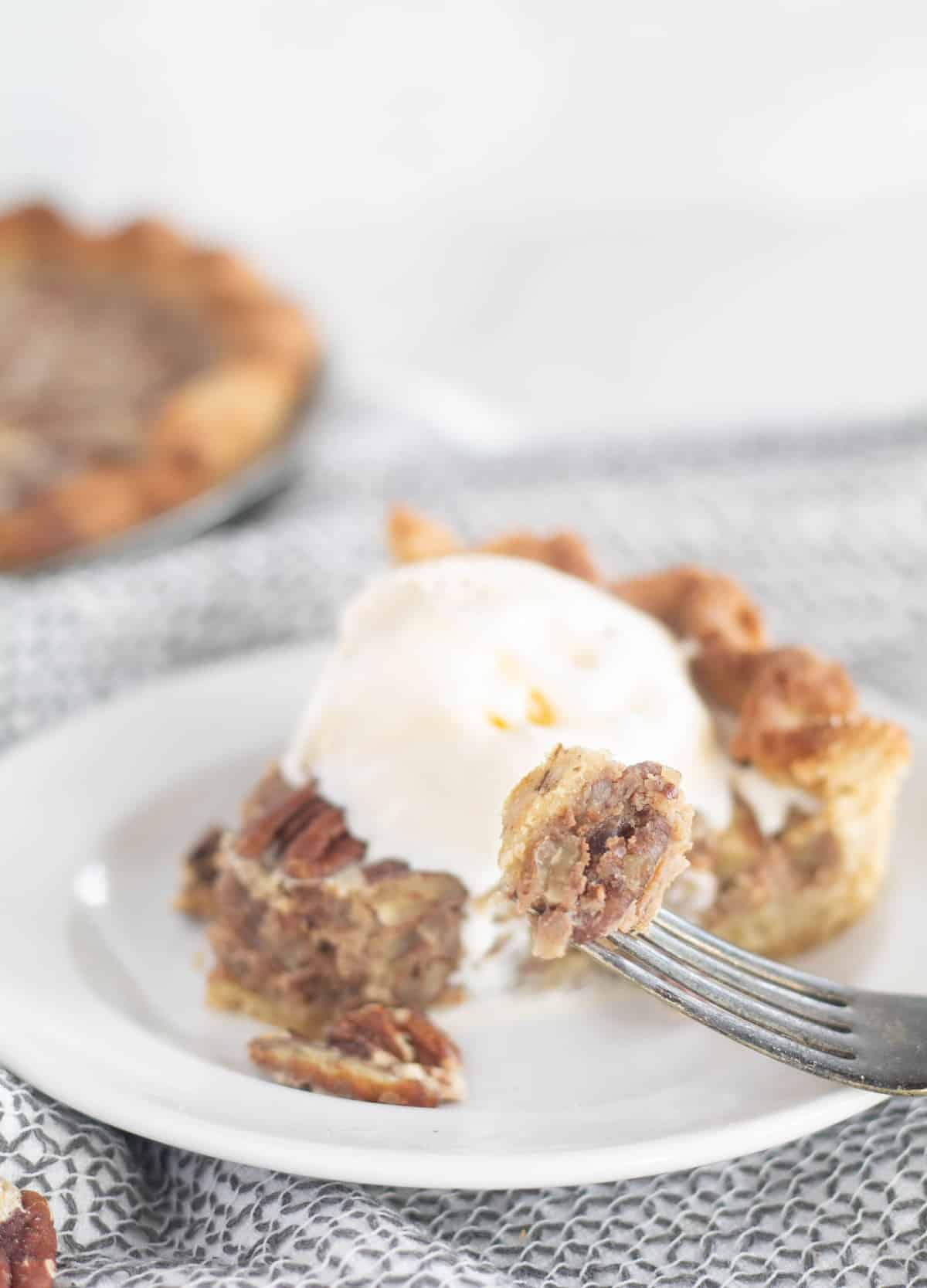 close up of paleo and keto pecan pie on a fork